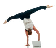 Businesswoman - acrobat working on laptop Royalty Free Stock Photos
