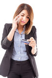 Businesswoman activating her credit card Royalty Free Stock Photography