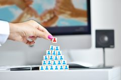 Businesswoman adding the final team employee or leader in a new structure or organization. Businesswoman adding the final team employee or leader in a new stock photography