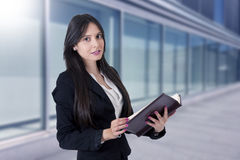 Businesswoman with address book royalty free stock photos