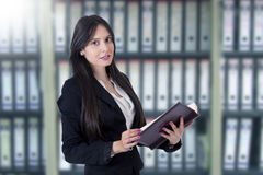 Businesswoman with address book stock image