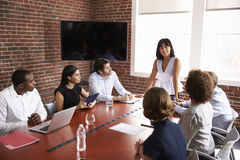Businesswoman Addressing Boardroom Meeting Stock Photos
