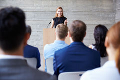Businesswoman Addressing Delegates At Conference Royalty Free Stock Photography