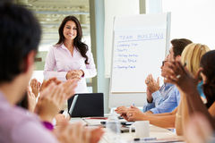 Businesswoman Addressing Meeting Around Boardroom Table Royalty Free Stock Photography