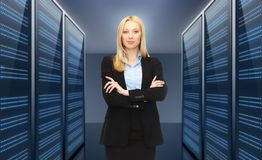 Businesswoman or admin over server room background Stock Photo