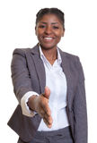 Businesswoman from Africa giving hand Royalty Free Stock Photo