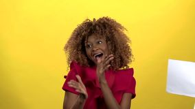 Businesswoman African American throws paper and rejoices. Yellow background. Slow motion. Businessman African American throws paper and rejoices in his victory stock video