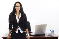 Businesswoman against office desk Stock Photography