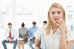 Businesswoman against people waiting for interview royalty free stock photo
