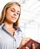 Businesswoman agenda stock photography