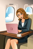 Businesswoman in the airplane. A vector illustration of a businesswoman working on her laptop in the airplane royalty free illustration