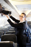 Businesswoman on airplane Royalty Free Stock Photo