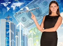 Businesswoman with airplane, skyscrapers and money Stock Photography