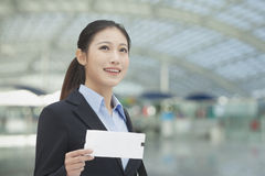 Businesswoman at the airport with airplane ticket Stock Photography