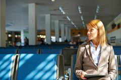 Businesswoman in airport Stock Images