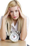 Businesswoman with an alarm clock Royalty Free Stock Image