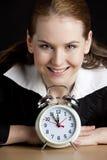 Businesswoman with an alarm clock Royalty Free Stock Photos