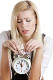 Businesswoman with an alarm clock Stock Photos