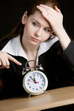 Businesswoman with an alarm clock Stock Photography
