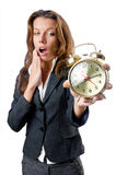 Businesswoman with alarm clock Stock Image