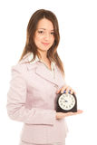 Businesswoman with alarm clock Stock Images