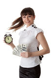 Businesswoman with alarm clock and money Royalty Free Stock Photography