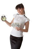 Businesswoman with alarm clock and money Royalty Free Stock Image