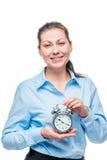 Businesswoman with alarm clock on white background Stock Photos