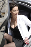 Businesswoman alighting from car Royalty Free Stock Image