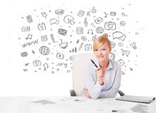 Businesswoman with all kind of hand-drawn icons Royalty Free Stock Image