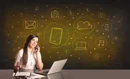 Businesswoman with all kind of hand-drawn media icons Royalty Free Stock Images