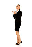 Businesswoman with an allergy sneezing into tissue Stock Photo