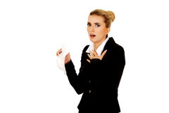Businesswoman with an allergy sneezing into tissue Royalty Free Stock Photography