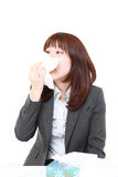 Businesswoman with an allergy Stock Photo