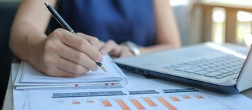 Businesswoman using laptop for analysis maketing plan stock photography