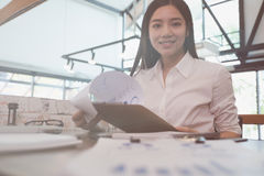Businesswoman analyze market chart at workplace. young female en Royalty Free Stock Photo