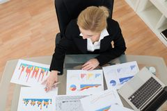 Businesswoman Analyzing Financial Graphs Stock Image