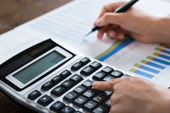 Businesswoman Analyzing Financial Report With Calculator Royalty Free Stock Photos