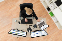 Businesswoman Analyzing Financial Statistics On Computer Stock Photos