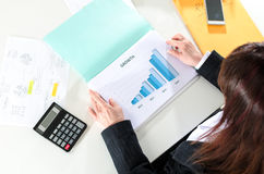 Businesswoman analyzing a graph Stock Image