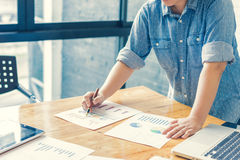 Businesswoman analyzing investment charts. Accounting. With soft focus, vintage tone Royalty Free Stock Image