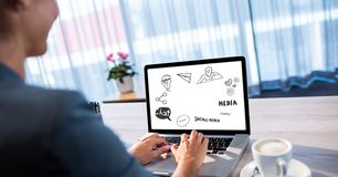 Businesswoman analyzing plan on laptop Royalty Free Stock Photos