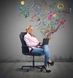 Businesswoman analyzing profits Stock Image