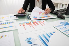 Businesswoman Analyzing Report On Chart Royalty Free Stock Images
