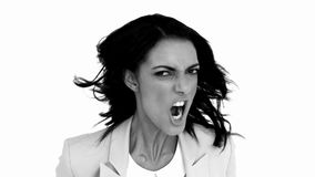 Businesswoman angrily shaking her head in black and white