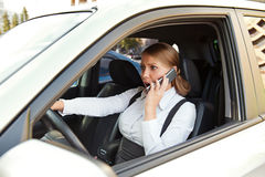 Businesswoman angrily talking on the phone Stock Photography