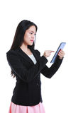 Businesswoman is in an angry mood with her digital tablet. Isolated on white background.. Young asian businesswoman is in an angry mood with her digital tablet royalty free stock images