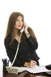 Businesswoman answering the phone Stock Photo