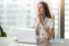 Businesswoman anticipates dearest wish comes true. Dreamy businesswoman anticipates dearest wish comes true. Happy young woman with exited facial expression stock photos