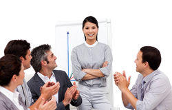 Businesswoman applauded for her presentation Stock Image